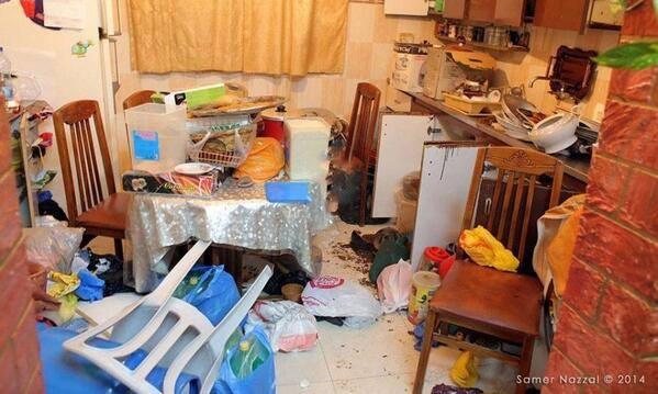 Kitchen after an Israeli army raid (Photo by Samer Nazzal)