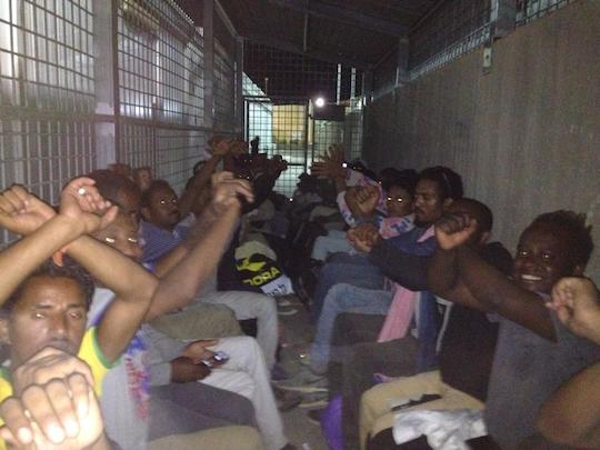 African asylum seekers waiting to be processed at Saharonim Prison, June 30, 2014. (Photo courtesy of Hotline for Refugees and Migrants)