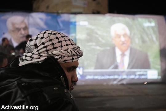 Palestinians watch PA President Mahmoud Abbas address the UN in 2012. (Photo by Yotam Ronen/Activestills.org)