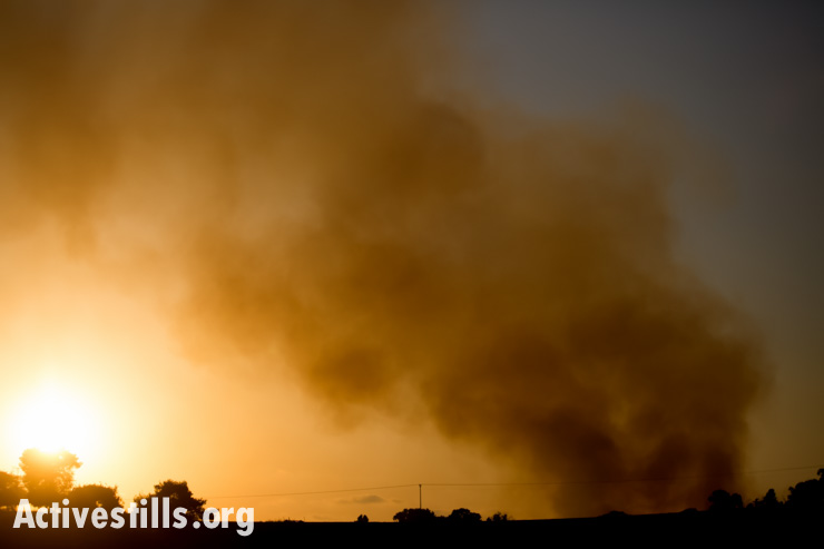 Smoke rises over the sky of Gaza following an Israeli air strike, July 8, 2014.