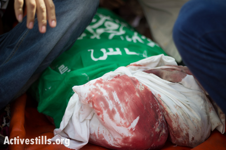 A members of the al-Batsh family is taken from Al Shifa Hosptial for his funeral, Gaza City, July 13, 2014. An Israeli airstrike on the family home of Tayseer Al-Batsh, Gaza's police chief, killed 18 people the previous day.