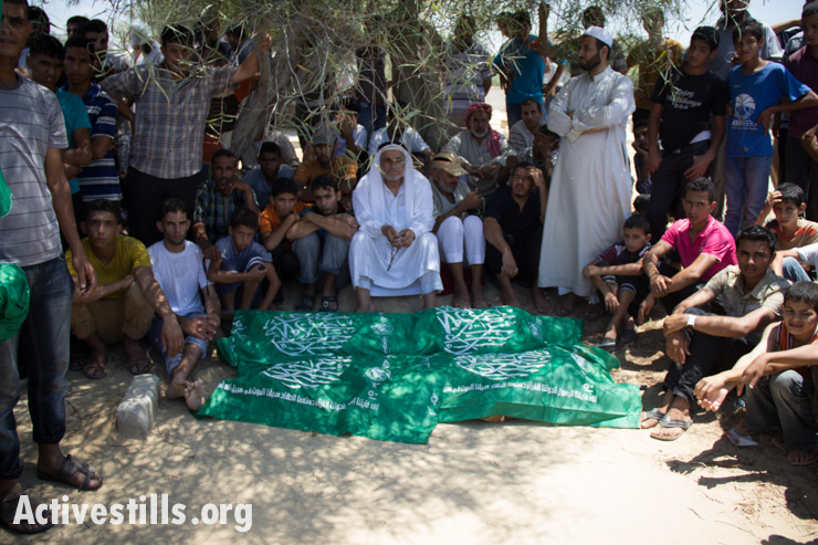 Bodies of members of the Abu Jamea family await burial.