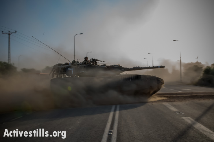 Israeli army tanks move towards the Israel-Gaza border on Wednesday, July 9, 2014. Israeli leaders threatened that a prolonged ground invasion is being considered.