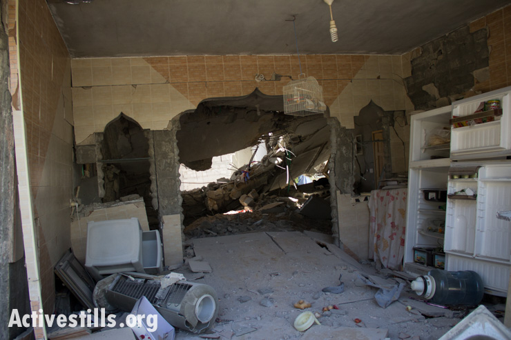 The kitchen of a house destroyed by Israeli air strikes in Gaza City, July 14, 2014.