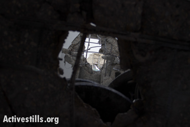 The view through holes punched through a Palestinian home in Gaza City, July 14, 2014.