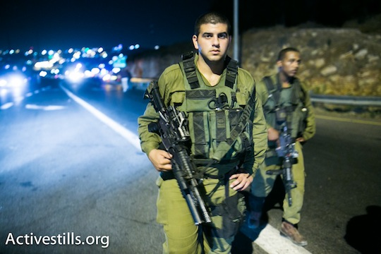 Israeli soldiers near the Palestinian city of Halhul, where the bodies of the three kidnapped Israeli teenagers were found. (Photo: Activestills.org)