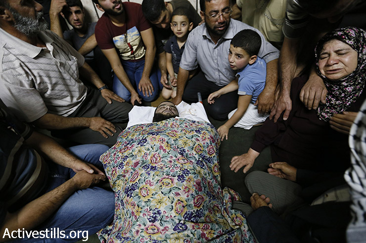 Family and friends of Mahmoud Hamamreh , 33, mourn during his funeral in the West Bank town of Husan, near Bethlehem, July 22, 2014. Mahmoud was shot in the chest with a live bullet during a protest against the Israeli attack on the Gaza strip in the West Bank village of Husan earlier on Wednesday. (Mustafa Bader/Activestills.org)