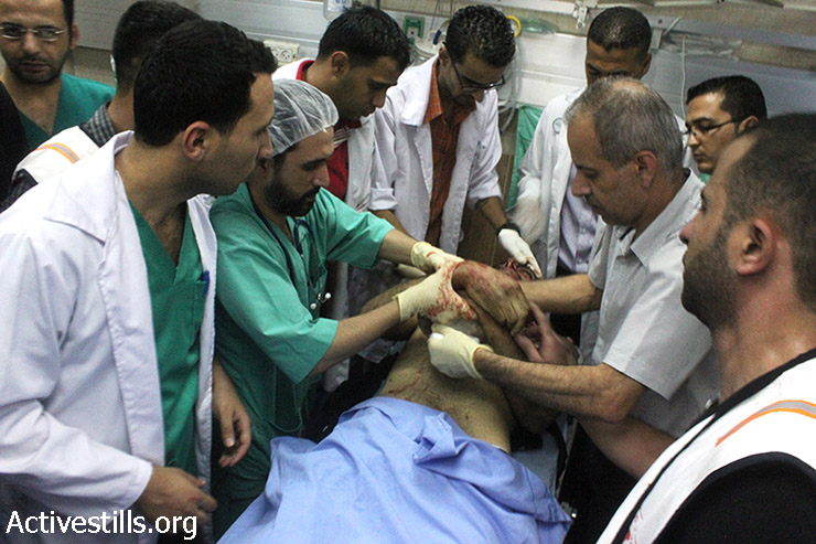 Khalid Azmi Odeh, 20, was shot to death with live ammunition by an Israeli settler from a vehicle in Huwwara village. 2 others were injured from the shooting. Rafedia Hospital, Nablus, July 25, 2014. (Ahmad Al-Bazz/Activestills.org)