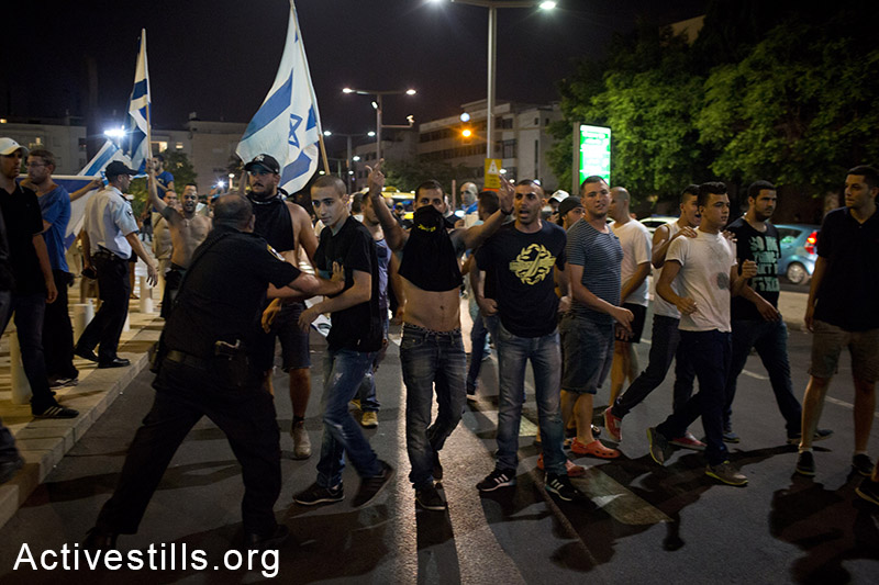 Right-wing nationalists attacking left wing activists during a protest in center Tel Aviv against the Israeli attack on Gaza, July 12, 2014. The protest ended with the nationalists attacking a small group of left-wing activists with little police interference. Three activists injured and one right-wing person arrested. (Oren Ziv/Activestills.org)