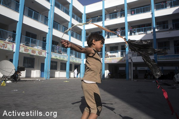Palestinian families take refuge at Remal Elementary UNRWA School in Gaza City after the Israeli military issued warnings to northern Gaza residents to evacuate the area, July 14, 2014. (photo: Active Stills)