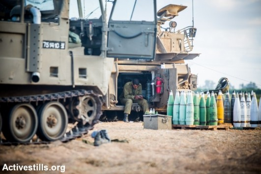 Israeli canons at an army deployment area near Israel's border with the Gaza Strip, on July 16, 2014. Operation 'Protective Edge' enters it's ninth day of Israeli air strikes on the Gaza Strip as yesterday's ceasefire agreement proposed by Egypt has failed to restore calm (photo: Activestills)