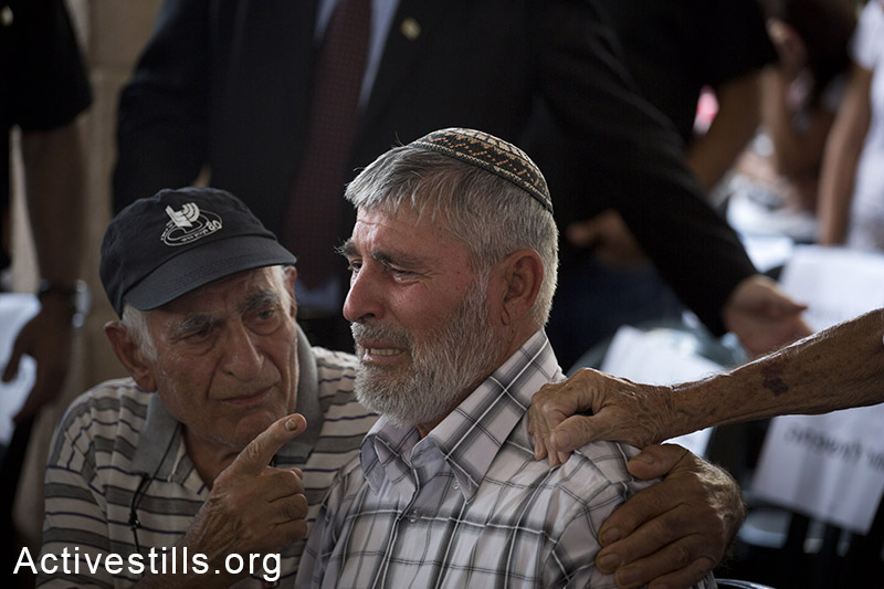 Dror Khenin's father mourn hum during the funeral ceremony,  July 16, 2014 in the city of Yahud, Israel. Khenin is the first Israeli to be killed by a rocket since Israel started the recent attack on the Gaza strip, as he offered food to Israeli soldiers near the Erez border crossing between Israel and Gaza. (Oren Ziv/Activestills.org)