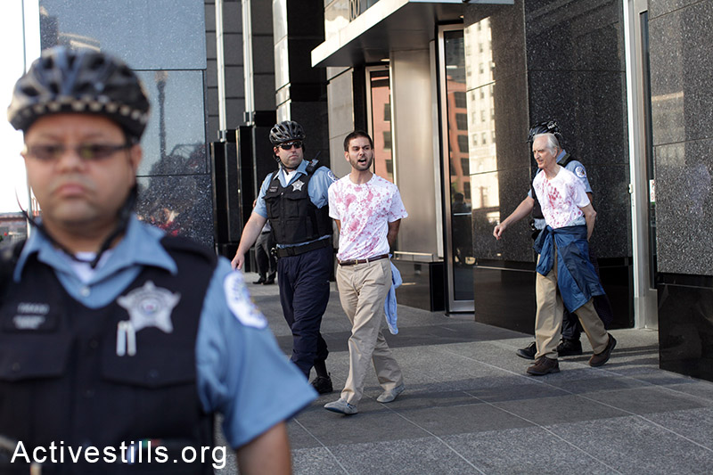Five activists were arrested during a direct action at Boeing International Headquarters in Downtown Chicago on July 16, 2014. The activists wore red stained shirts and protested Boeing's involvement in the deaths of Palestinians during the recent Israeli offensive in Gaza. (Tess Shcaflan/Activestills.org)