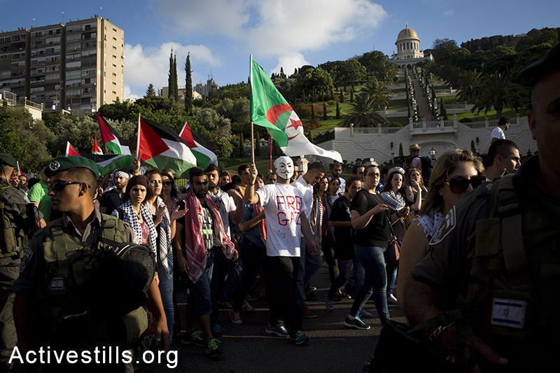 Palestinians living in Israel and left-wing activists protest against the Israeli attack on Gaza in downtown Haifa, July 18, 2014. Israeli police arrested 28 activists, as protesters took the streets and blocked roads, calling to put an end to the attack. (Oren Ziv/Activestills.org)
