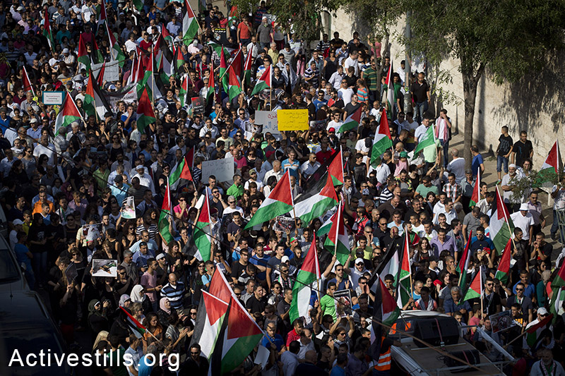 Palestinians living in Israel march during a protest against the Israeli attack on Gaza, in the northern city of Nazareth, July 21, 2014. Police used tear gas and a water canon to disperse the protest, arresting at least 10 youths. (Oren Ziv/Activestills.org)