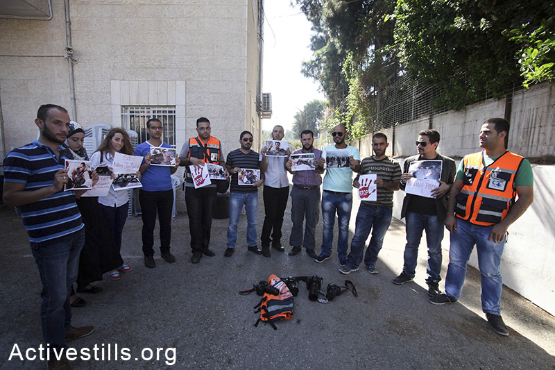 Palestinian journalists and photographers protest the killing of Palestinian cameraman Khaled Hamad outside the offices of the Red Cross in the East Jerusalem neighborhood of Shiekh Jarrah, July 21, 2014. Hamad was killed in Gaza during the Israeli artillery shelling of the city's Shujaya residential district on July 20th, 2014. (Fiaz abu-Ramele/Activestills.org)
