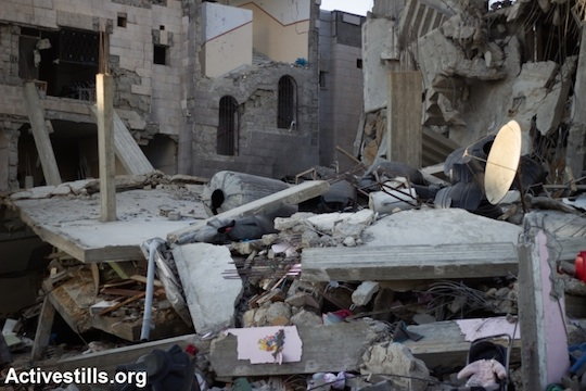 The Abu Leila family home in the Al Sheikh Radwan neighborhood, which was destroyed by an Israeli Airstrike early Friday morning, Gaza City, July 11, 2014. The neighborhood was severely damaged. (Photo: Basel Yazouri/Activestills.org)