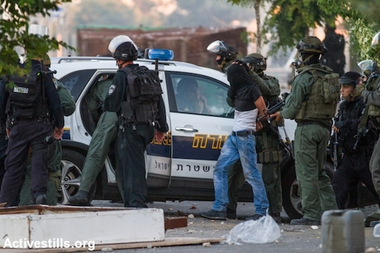 Israeli police arrest a protester during the second day of protests that followed the kidnapping and murder of a Palestinian teenager, East Jerusalem, July 3, 2014. (Photo by Faiz Abu Rmeleh/Activestills.org)