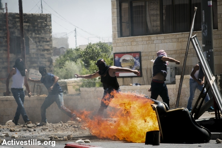 Palestinian youths clash with Israeli forces during a protest following the suspected kidnapping and murder of a Palestinian teenager, East Jerusalem, July 2, 2014. (Photo by Yotam Ronen/Activestills.org)