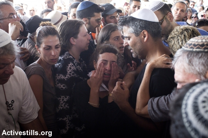 Mourners at Dror Khenin's funeral. Khenin was killed near the Gaza border by mortar fire while delivering food to Israeli soldiers. (photo: Activestills.org)