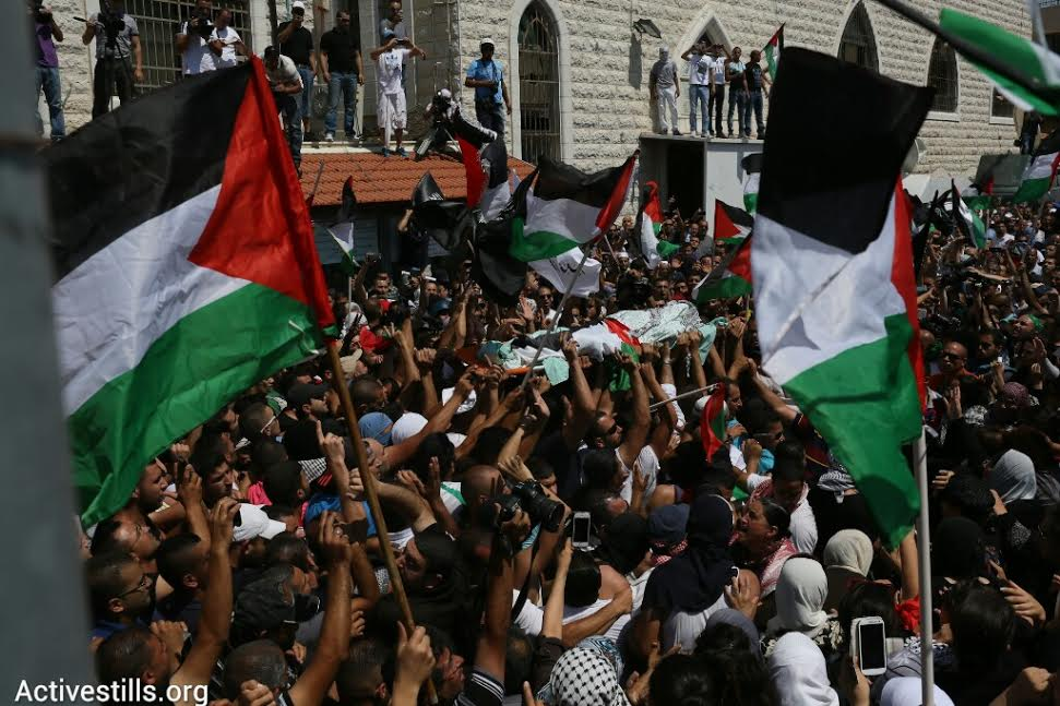 Thousands of Palestinians attend the funeral of Muhammad Abu Khdeir. (photo: Oren Ziv/Activestills.org)