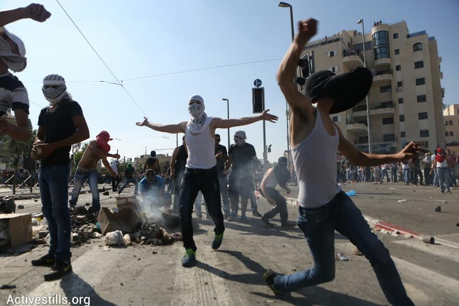 Palestinian youth throw rocks at Israeli security forces during clashes in Shuafat. The clashes erupted during the funeral for Muhammad Abu Khdeir, a 16-year-old Palestinian who was suspected of being murdered by Jewish nationalists in Jerusalem. (photo: Oren Ziv/Activestills.org)