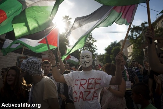 Palestinian protesters march in Haifa against Operation Protective Edge. (photo: Oren Ziv/Activestills.org)