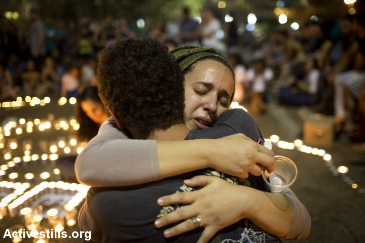 Israeli mourners console each other during a memorial for the three murdered teens in Rabin Square, Tel Aviv, June 30, 2014. (Photo: Activestills.org) Israelis gathered in public squares in Tel Aviv, Jerusalem and other major cities to publicly mourn the three yeshiva students, who were missing for over two weeks before being found dead in the southern West Bank Monday.