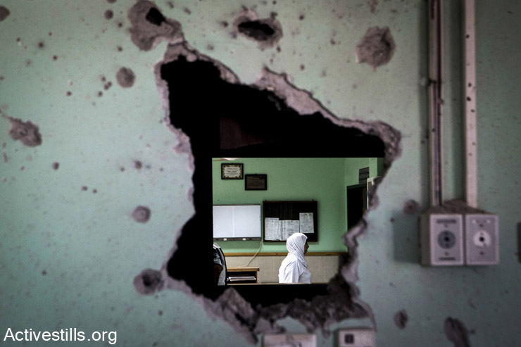 Damage is seen inside the Al Aqsa hospital following an Israeli attack, Deir al-Balah, in central Gaza, July 26, 2014. The direct attack, which took place on July 21, killed at least five Palestinians and injured 70. (Anne Paq/Activestills.org)