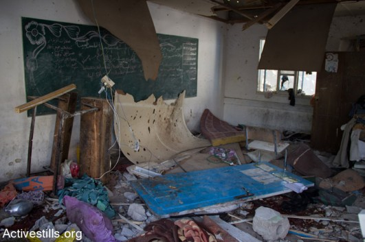 A classroom lies damaged following the overnight Israeli shelling of an UNRWA school where some 3,300 Palestinians were seeking shelter, Jabalia, Gaza Strip, July 30, 2014. At least 20 people were killed in the attack which injured more than 100.  (Basel Yazouri/Activestills.org)