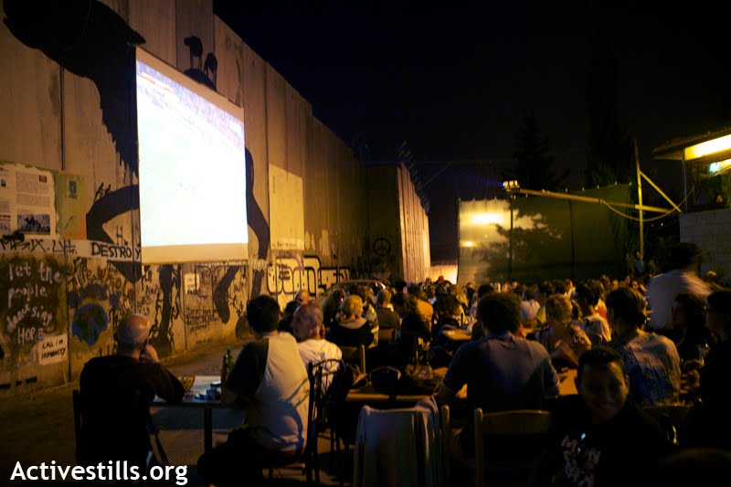Palestinians in Bethlehem gather to watch the World Cup. (photo: Activestills.org)