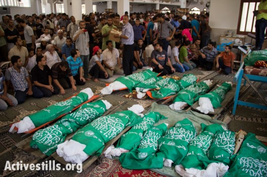 Mourners fill the mosque during the funeral for 26 members of the Abu Jame' family, who were killed the previous day during an Israeli attack on the Bani Suhaila neighborhood of Khan Younis, Gaza Strip, July 21, 2014. Reports indicate that 15 of the 24 killed were children of the Abu Jame' family. (photo: Activestills)
