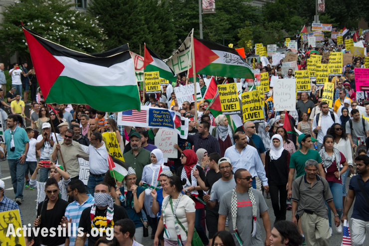 Some 10,000 demonstrators march through downtown Washington, D.C., to protest Israel's offensive in Gaza, August 2, 2014. So far, Israeli attacks have killed at least 1,622 Palestinians, the majority of them civilians, including 326 children. (Activestills.org)