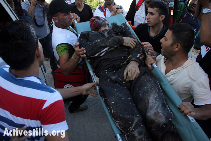 The body of Zakaria Al-Aqra, 24, after he was killed by the Israeli army in the West Bank village of Qabalan, Nablus, August 11, 2014. Al-Aqra was wanted by Israel.(photo: Activestills.org)