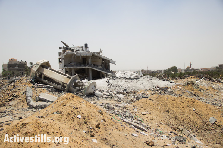 A mosque's shattered minaret lies among the ruins of the Palestinian village of Khuza'a following bombardment by Israeli forces, August 1, 2014.