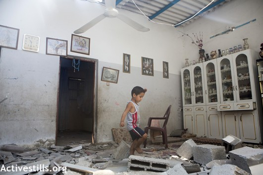 A child amidst the rubble of his home, which had been destroyed the night before in Gaza. (photo: Anne Paq/Activestills)