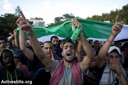Palestnians living in Israel take part in a protest against the attack on Gaza in the city of Lod, Israel, August 3, 2014 (Activestills)
