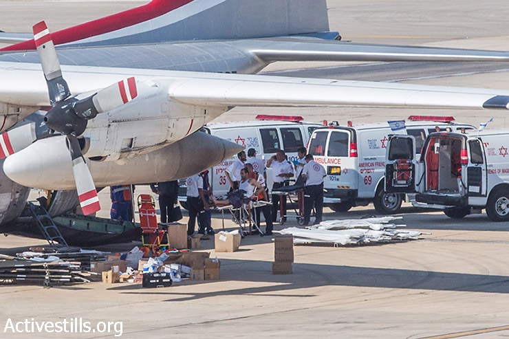 Eighteen Palestinians injured during the Israeli attack on the Gaza Strip are seen at Ben Gurion Airport in Tel Aviv, a distance of around 70 kilometers from Gaza, before being taken to hospitals in Turkey by a Turkish military plane, Israel, August 13, 2014. (Yotam Ronen/Activestills.org)