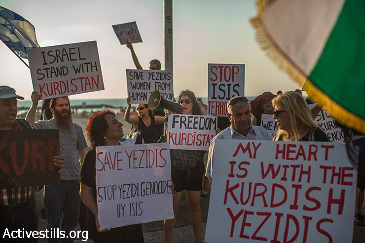 Israelis of Kurdish origin demonstrate in solidarity with the Yazidi community in front of the U.S. Embassy in Tel Aviv, August 13, 2014. The Yazidi community in northern Iraq has recently been attacked by extremists of the Islamic State. The protesters called for U.S. intervention. (Yotam Ronen/Activestills.org)