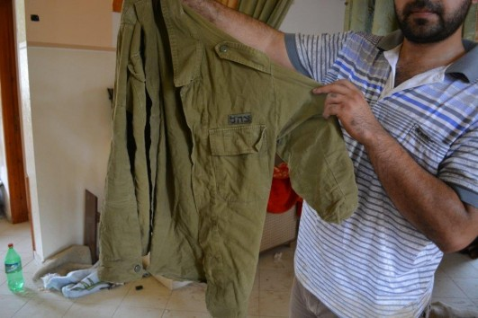 An IDF shirt left behind in a house used as a military post by Israeli soldiers during Operation Protective Edge, the Gaza Strip, August 2014. (photo: Alexandr Nabokov)