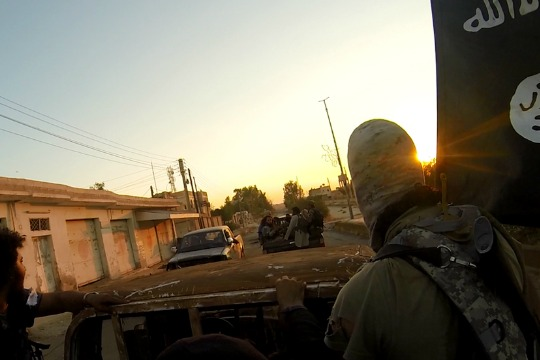 ISIS fighters ride through the Syrian city of Al-Raqqa. (photo: Islamic State)