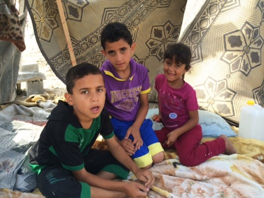 As bombs fall, the Kafarnah family is camped across from where their home used to stand in Beit Hanoun (photo: Samer Badawi)