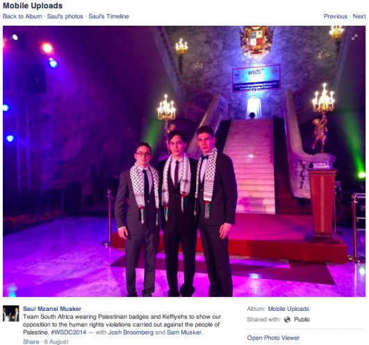 A screenshot of a Facebook post in which Josh Broomberg is seen wearing a keffiyeh at the opening of the World Debating Championships in Thailand, August 6, 2014 (Facebook)