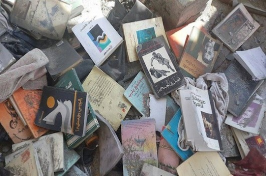 Burned books from the collection of Gaza poet Othman Hussein (photo: Maysoon Hussein)