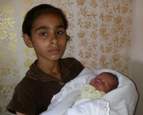 Rasha's sister holds the baby that was save (photo: Awni Farhat)