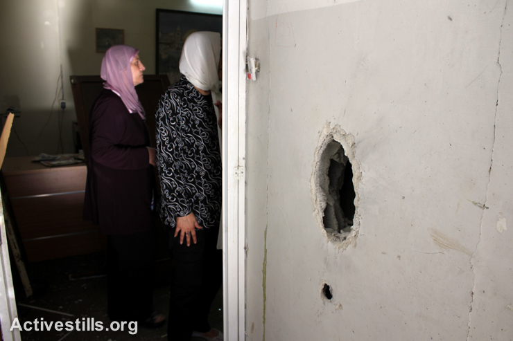 Residents inspect damage to a center for children with disabilities after the building was raided by Israeli forces, Nablus, West Bank, September 3, 2014. (Activestills.org)