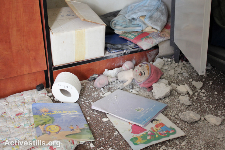 Books and toys lie covered in dust and rubble after a center for children with disabilities was raided by Israeli forces in the West Bank city of Nablus, September 3, 2014. (Activestills.org)