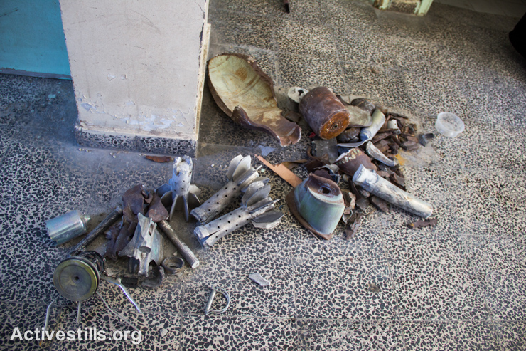 A pile of various parts of Israeli shells, bombs, and mortars collected in Sobhi Abu Karesh governmental school, which was damaged by an Israeli attack during the latest offensive, in Shujaiyeh neighborhood, east of Gaza City, September 4, 2014. (Activestills.org)