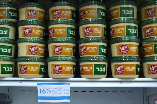 A sticker urges Palestinians not to buy Israeli-made hummus. (Photo: 16% Kills Facebook page)