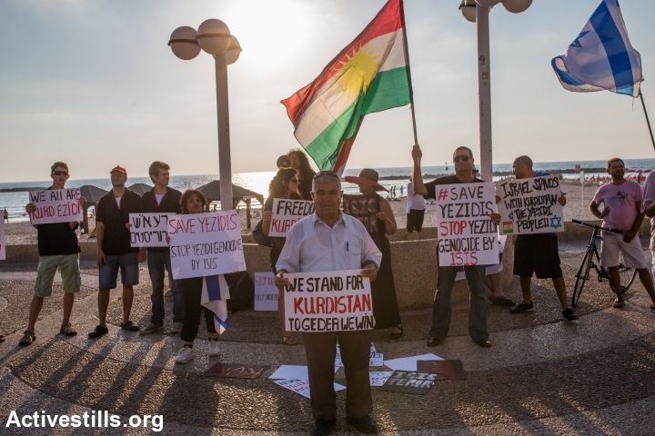 Israelis of Kurdish origin demonstrate in solidarity with the Yazidi community in front of the American Embassy in Tel Aviv, August 13, 2014. The Yazidi community in northern Iraq has recently been attacked by extremists of Islamic State. The protesters called for U.S intervention. (Yotam Ronen/Activestills.org)